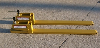 Model WOBF-4000 pair of clamp-on bucket forks with 4000 lbs. total load capacity, total overall length is 56.5 inches, useable length is 42 inches, tine size is 4 inches wide x 2 inches thick.