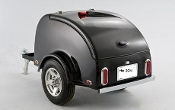 ION motorcycle and car and truck towable cargo trailer, available in black or white painted finish, or primer finish, or optional 1 or 2 color, with white painted wheels standard, aluminum or chrome optional