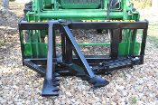 Model 515000 Tractor Loader and Skid Steer Loader Mount Tree Puller Unit requires purchase of optional loader brackets to mount to your loader; available option is a metal brush guard.