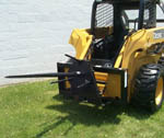Model WOSSSO-908 Hydraulic, skid steer mounted, round bale unloader.