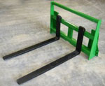 Model WOJDPF-5442 integrated frame pallet forks for John Deere 400 and 500 series loaders. Maximum lift capacity is 4000 lbs. Forks are 42 inches long x 4 inches wide x 1 1/4 inches thick.