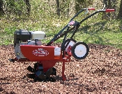 Model IT800IC Mackissic International model walk behind roto-tiller, adjustable tilling width from 14 to 26 inches standard, and up to 37 inches wide with optional extension kit.