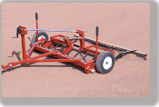 Model 10003315 Dirt Medic 4 ft. wide infield groomer, tow behind garden tractor, ATV, or small UTV, has scarifier teeth and grooming brush, weighs 200 lbs.