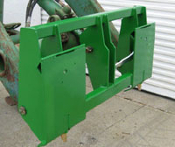 Model 832815 Adapter Plate John Deere 48 and 58 series tractor loaders on back side, an skid steer quick attach implements connect to the front side.