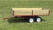 Model 7500 Tandem Axle Trailer bed is 7 ft. long x 38 inches wide, has 12 inch tall removeable side boards made from treated lumber