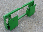 Model 831980 Adapter Plate connects to John Deere Tractor Loaders models 240, 245, 260, 265, allows you to connect to skid steer attachments.